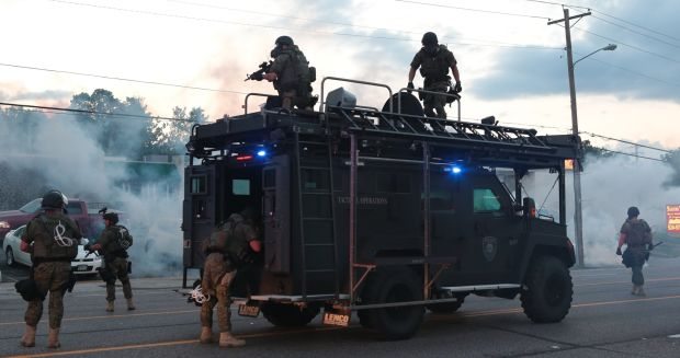 Tactical officers fire tear gas in Ferguson
