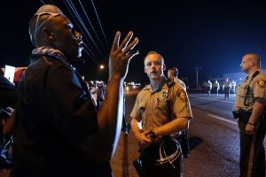 ACLU wants police banned from keeping Ferguson protesters moving
