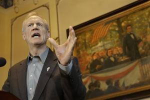 Gov. Rauner pushes for spy agency move to Illinois site near Scott Air Force Base