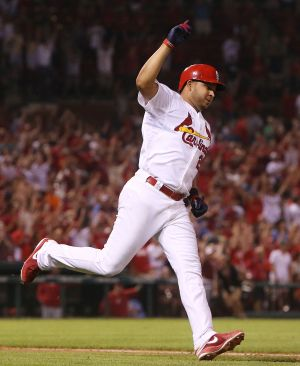 Cards beat Reds in extras on Peralta's single