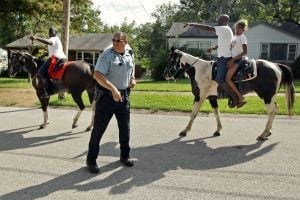 Photos: Men on horseback help detain Ferguson robbery suspect