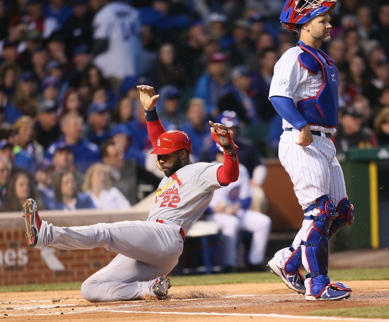 Heyward leads Cards over Cubs