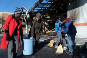 Clean up in Ferguson after night of fires, looting