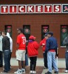 Fans buying tickets