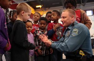 Police officers provide early Christmas for Ferguson kids