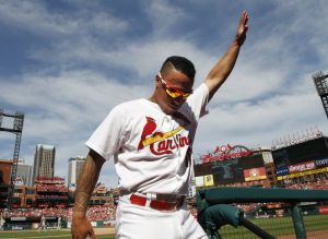 Cards beat Pirates to take division lead