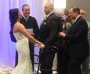 Robotic device helps paralyzed groom walk aisle