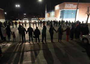 Protesters chant outside Ferguson police department, four arrested