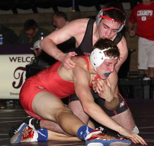Triad stumbles in the quarterfinals at the dual team state champ