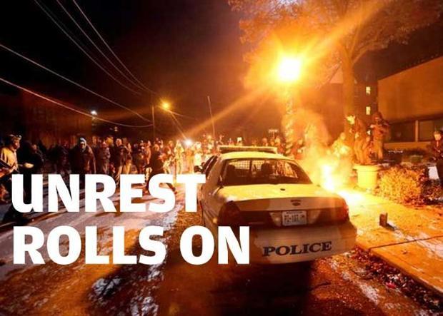 Police make dozens of arrests as Ferguson protests roll on