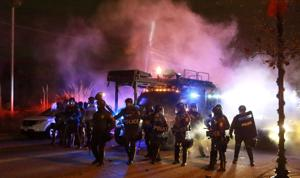 IN FERGUSON: Businesses burn, police cars torched as violence 'much worse' than August