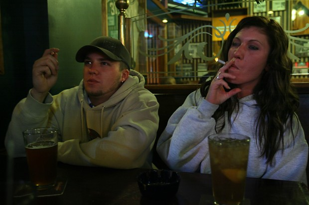 Fewer adults  are smoking, as rate dips to 18 percent, report says
