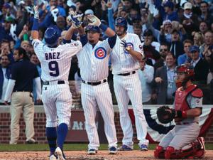 LIVE: Action photos, Game 4 Cards v. Cubs