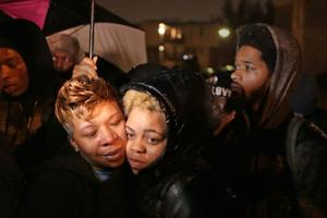 Michael Brown's mother joins protesters Saturday night, urges peace; two arrested