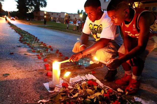 Father of Michael Brown visits memorial to son