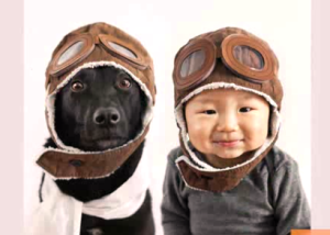 Dog and toddler wear matching outfits in photo series