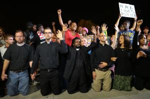 Reverend who protested in Ferguson goes on trial for refusal to disperse