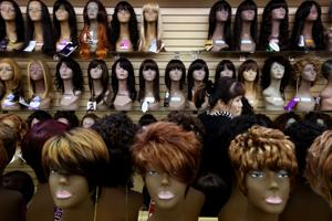 Beauty World in Ferguson reopens after damage following Grand Jury decision