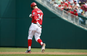 Harper benched as Cards win