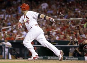 Holliday breaks Cardinals record, sets National League one