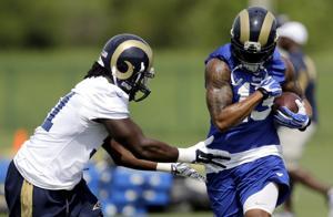 Rams cut two, reach 75-man limit