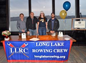 Local rower signs with University of Notre Dame