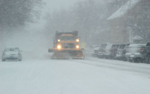 Bus slides into ditch; no injuries