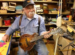 Shakopee artist carves coins, crafts musical instruments