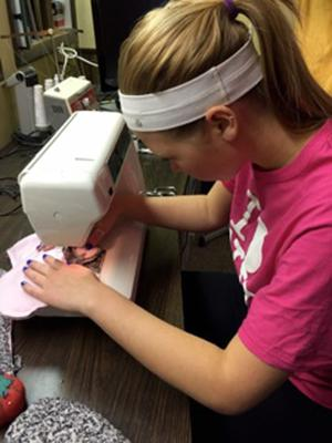 Love, loss and mittens: Two BHS seniors honor one's mother, help others