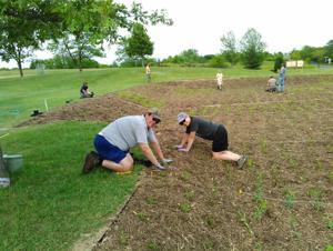 Family of Christ rain garden  helps keep Bluff Creek clean