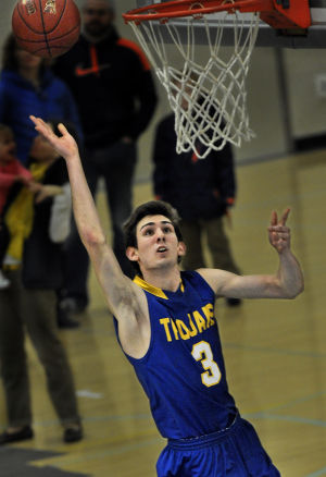 Trojans, Spartans advance in basketball playoffs