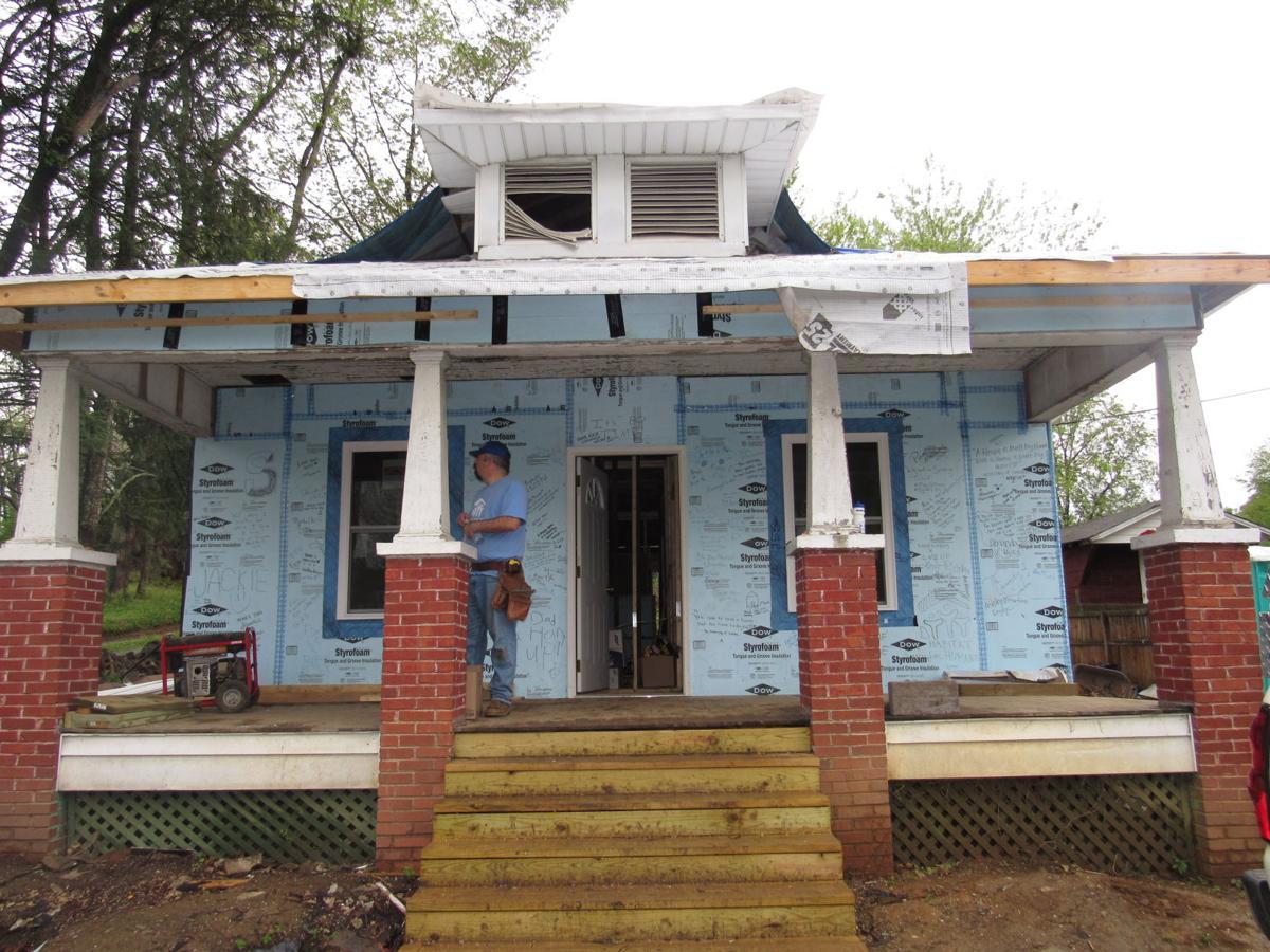 Habitat for humanity volunteers begin renovating old for Habitat for humanity houses for rent