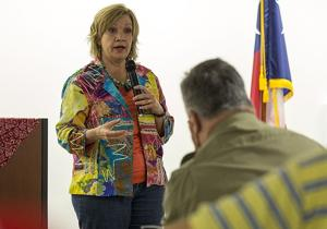 <p>Molly White speaks during a town hall meeting at the Temple Public Library on Saturday.</p>