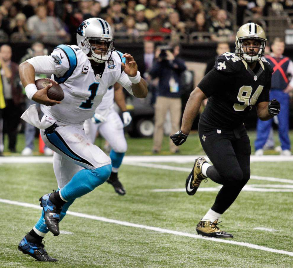 Cam Newton, Panthers run wild on Saints _lowres