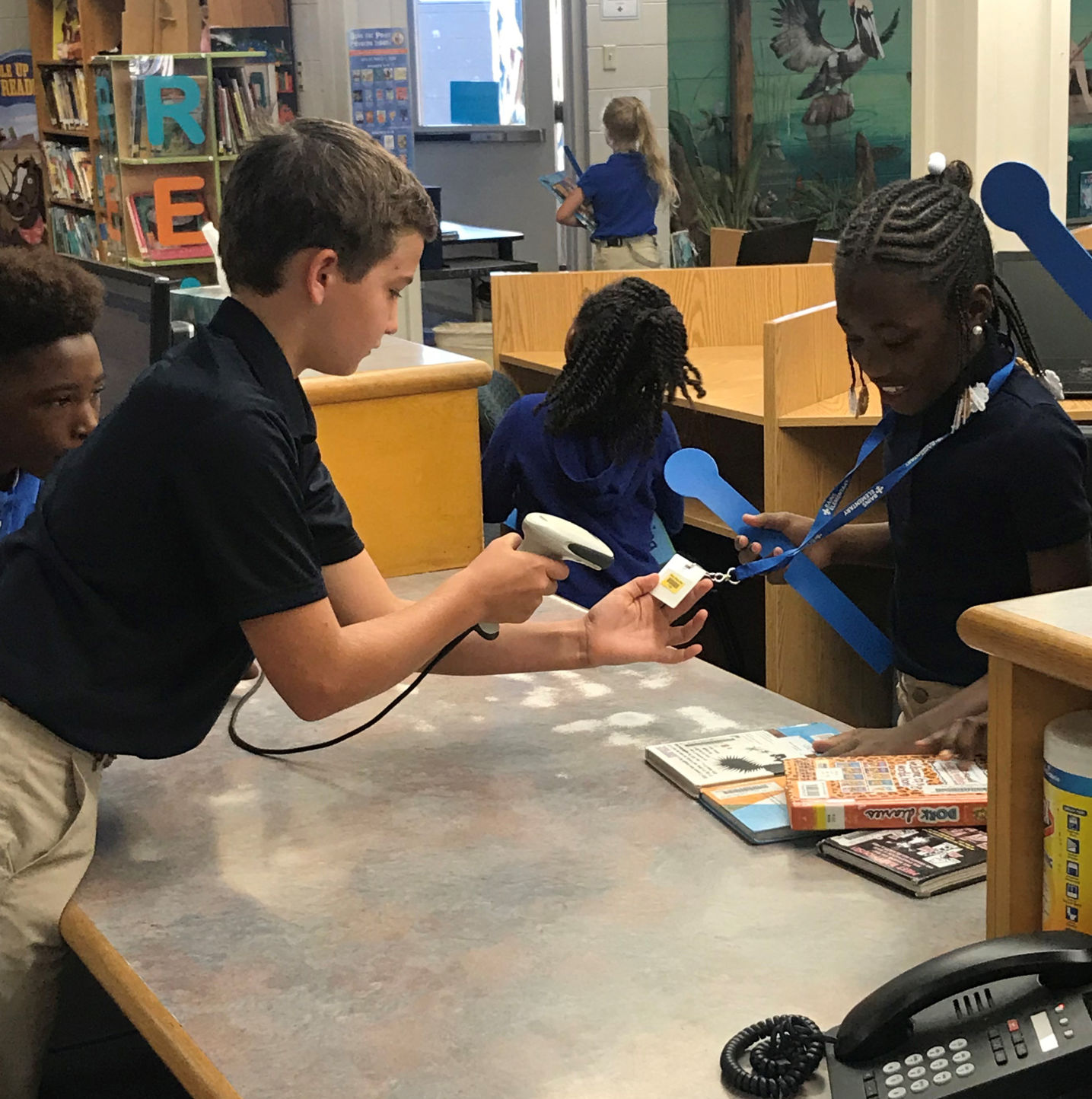 Student help out in library at Bains Elementary
