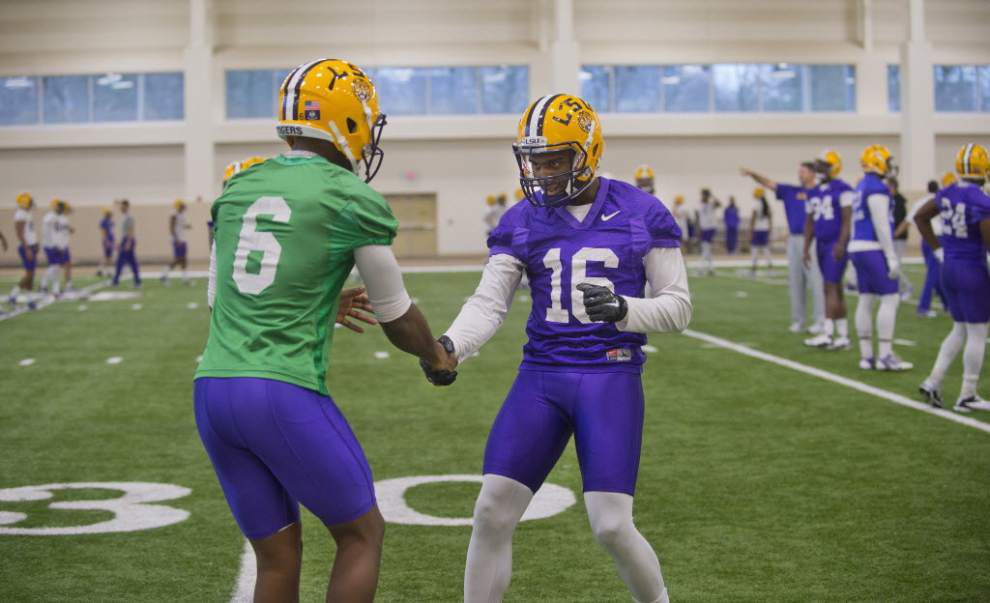 LSU quarterback Brandon Harris throws touchdown pass to receiver D.J. Chark in scrimmage _lowres