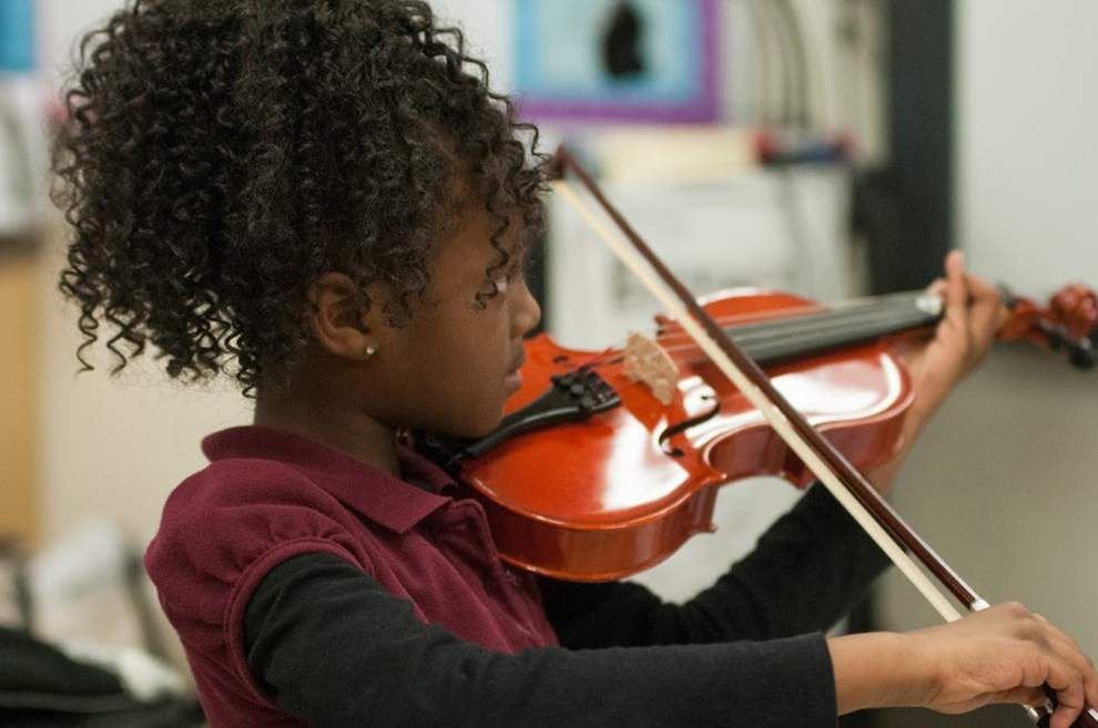 Orchestra gives children of all backgrounds an outlet to develop skills, teamwork _lowres