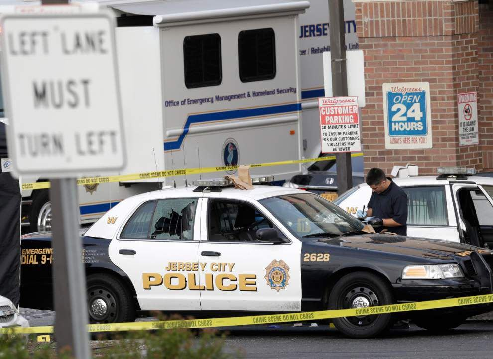Jersey City officer shot, killed on robbery call _lowres