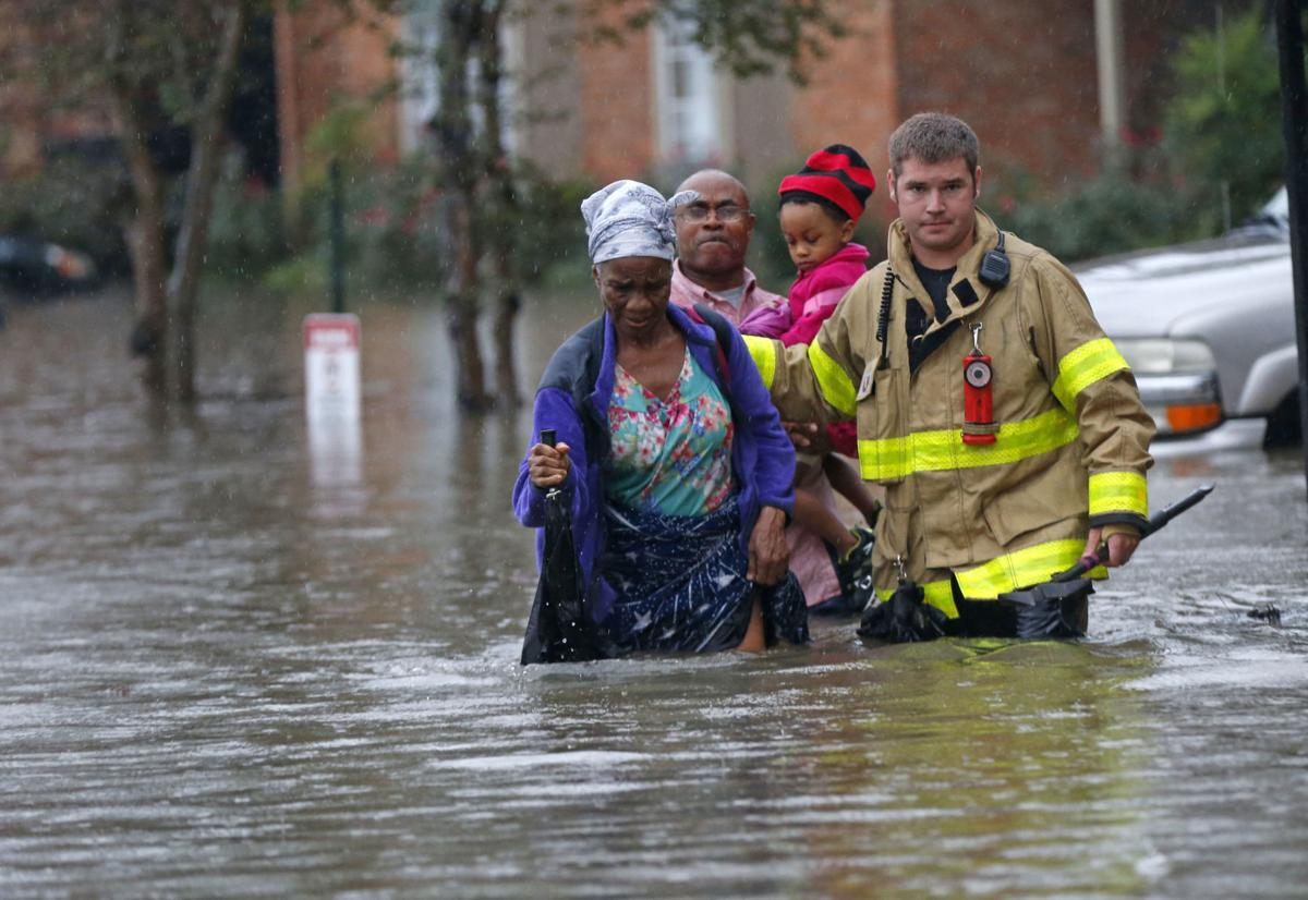 Videos St George Firefighters Help Woman From Flooded Apartment Complex Unload An Inflatable