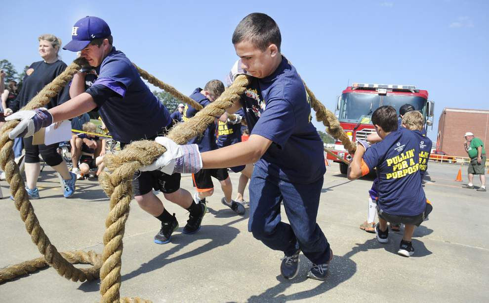 Teams pull fire trucks for Special Olympics _lowres