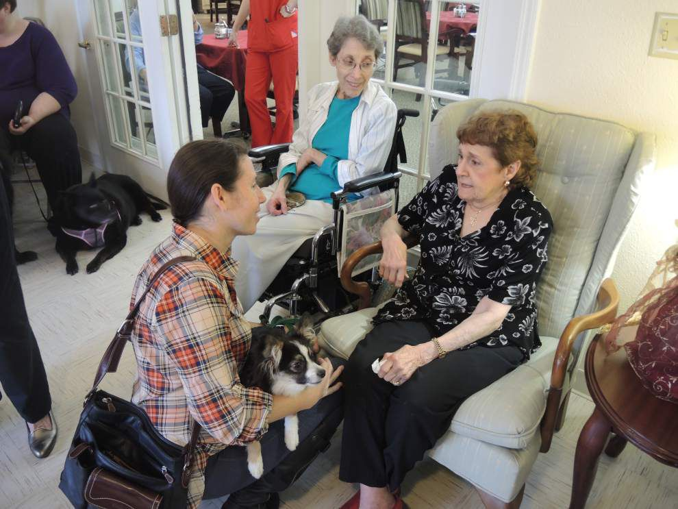 4-H members, pets visit senior citizens _lowres