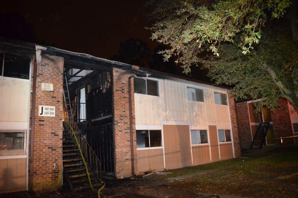 Apartment fire said to be arson sends five to the hospital _lowres