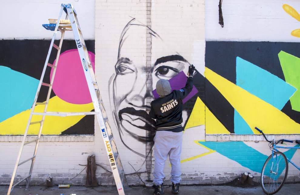 Volunteers work to freshen up sections of midcity on Martin Luther King Jr. Day _lowres
