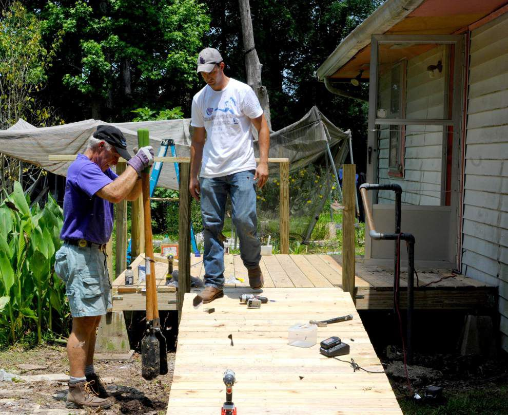 Rotarians help to rebuild Zachary home _lowres