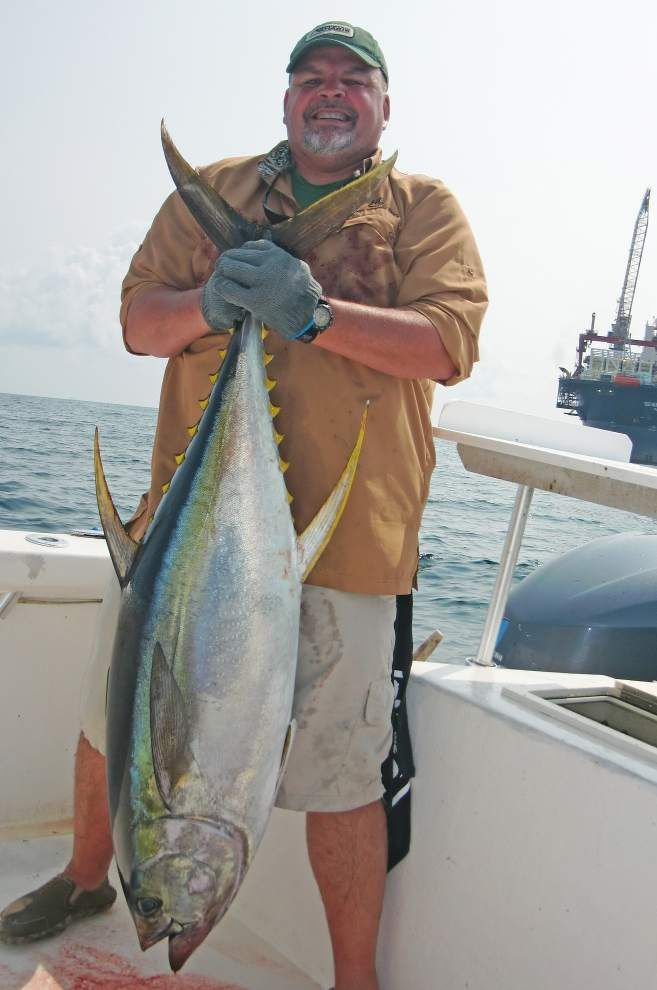 Group brings in hefty yellowfin tunas with different strategies _lowres