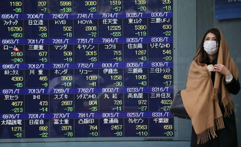 World stocks slide on emerging market woes _lowres