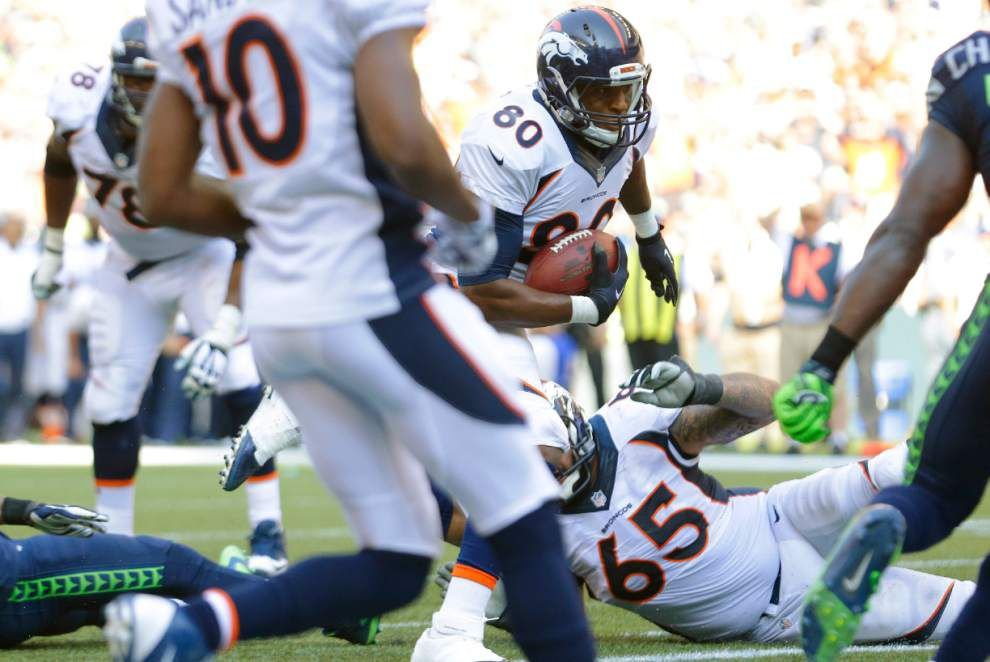 Russell Wilson, Marshawn Lynch help Seattle hold off Broncos 26-20 in OT _lowres