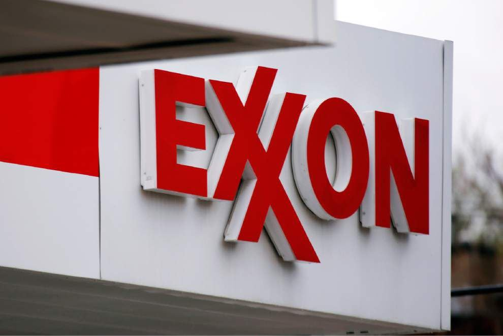 Exxon's 4Q and annual profit plunge with oil prices _lowres