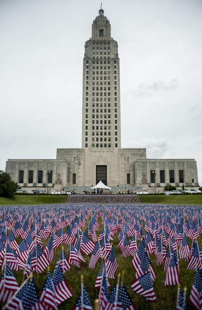 Families, friends gather at State Capitol to honor those killed in service _lowres