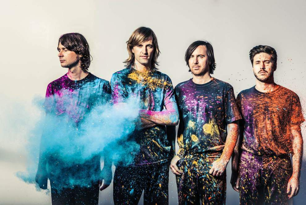 Australian electronic pop band Cut Copy keeps an eye on the soccer match _lowres